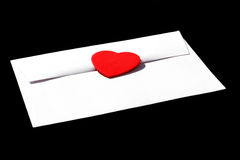 Love Letter. White letter sealed with a heart royalty free stock images