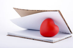 Love letter. Red heart in the notepad Royalty Free Stock Photos