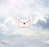 Love letter with angel wings. On sky royalty free stock image