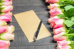 Love letter bouquet of pink roses, free space and pen Royalty Free Stock Photography