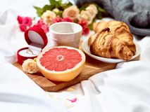 The Love letter concept on table with breakfast. Coffee, cake, flowers, ring. Concept of wedding ring, marriage proposal Royalty Free Stock Photography