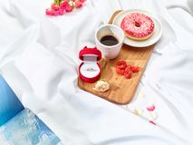 The Love letter concept on table with breakfast. Coffee, cake, flowers, ring. Concept of wedding ring, marriage proposal royalty free stock images