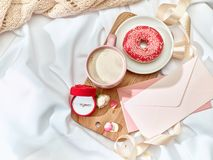 The Love letter concept on table with envelope. Coffee, cake, flowers, ring. Concept of wedding ring, marriage proposal Royalty Free Stock Images