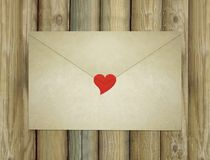 Love Letter Envelope Enclosed by a Red Heart Stock Photos