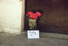 Love Letter and Flowers. Love Letter and Red Roses in Vase in Front of Doorway-Love Concept Royalty Free Stock Images