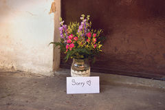 Love Letter and Flowers. In Vase in Front of Doorway-Love Concept Stock Photo