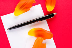 A love letter with four petals. On a red background Royalty Free Stock Photo