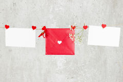 The love letter hangs on rope and a flower on a light background Stock Photo