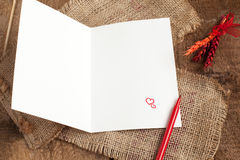 Love letter with heart shape cookies, and red pen Royalty Free Stock Image