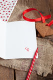Love letter with heart shape cookies, and red pen Stock Images