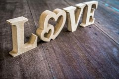 Love letter made from wood on the old wooden floor Royalty Free Stock Images