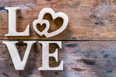 Love letter made from wood on the old wooden floor Stock Photography