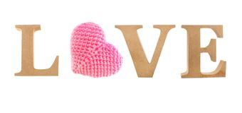 Love letter made from wood with pink heart knitting. Isolated white background Stock Photo