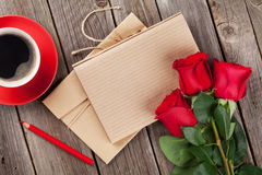 Love letter notepad, red roses and coffee cup Royalty Free Stock Images