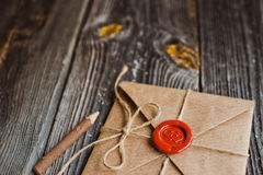 Love Letter and pencil. Love letter with wax seal and a wooden pencil royalty free stock image