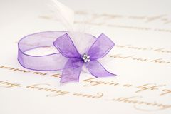 Love letter and purple ribbon Stock Photos