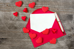 Love letter with red hearts Royalty Free Stock Images
