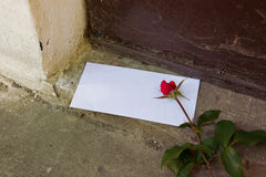 Love Letter and Red Rose. In Vase in Front of Doorway-Love Concept Stock Images