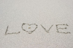Love letter and ring on sand Stock Photography