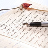 Love letter with a rose. And pen Stock Photography