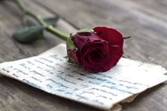 Love letter and rose. On wooden background,close up Stock Images