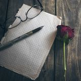 Love letter and rose on wooden background Stock Images