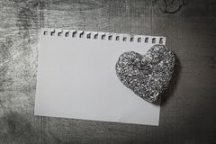 Love letter template on paper and stone heart on wooden rustic desk. Horizontal top view Royalty Free Stock Photos