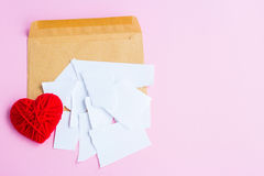 Love letter torn with red hearts Stock Photography