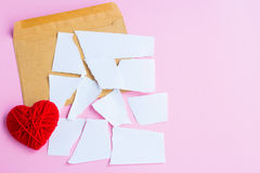 Love letter torn with red hearts Stock Photo