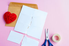 Love letter torn with red hearts Royalty Free Stock Photography