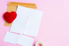 Love letter torn with red hearts Royalty Free Stock Images