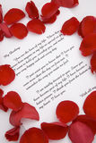 A love letter for Valentines day. A romantic love letter with rose petals for Valentines day Stock Photos