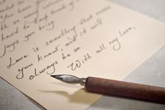 Love letter and vintage dip pen with wooden handle Royalty Free Stock Photo