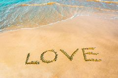 LOVE lettering on the beach with wave,Copy space stock photography