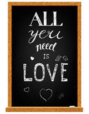 Love lettering on chalkboard Stock Images
