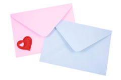 Love letters. Two envelopes blue and pink with red heart isolated on white royalty free stock image