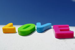 Love letters. View of word love,with letters of different colors,positions and focus,with blue sky Stock Photos