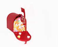 Love letters. Candy hearts in a red mailbox royalty free stock image
