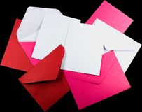 Love Letters. Blank letters and envelopes for a sweety or loved one. Isolated on a black background Stock Photography