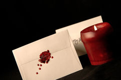 Love Letters. Love Letter with wax seal and red candle Stock Photography