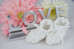 Love in letters with babysocks Stock Images