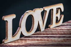 Love letters cut from plywood Royalty Free Stock Photos