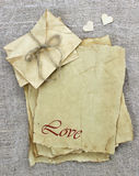 Love letters and envelopes made of antique parchment paper with wooden hearts on background Royalty Free Stock Photo