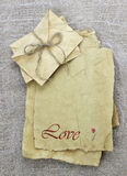 Love letters and envelopes made of antique parchmnet paper with red flower Stock Photography