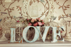 LOVE letters on floral background Stock Image