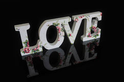 Love letters. Love with a floral design reflected on a black background Royalty Free Stock Photography