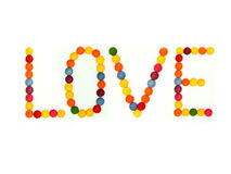 Love. Letters are made of colored candy Stock Image
