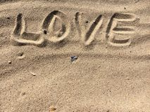 LOVE letters made with sand on a beach Stock Photos