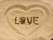 LOVE letters made with stones on a beach Royalty Free Stock Photography