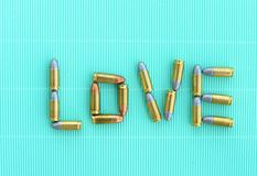 Love letters by 9 mm bullets on green vintage background Stock Photos